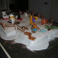 Winter Fun Time On one side of the cake are animals enjoying skiing and sledding, while on the other side animals are roasting marshmallows to make smores...