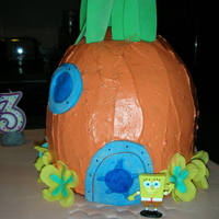 Spongebob Squarepants  This cake is made from 8-9 inch round cakes stacked and then carved into the shape of a pineapple. I tinted regular buttercream frosting...