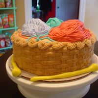 Knitting Basket Cake  German chocolate cake with buttercream icing, yarn is buttercream on balls of mmf. Needles are mmf also. Made for my roommate who likes to...