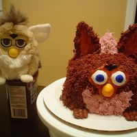 Furby Cake   3-9inch cakes, gumpaste face, accents and ears--chocolate buttercream. Made for bf's birthday who loves furbys!