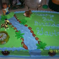 Diego Cake  This was for my grandson's 3rd BD. All buttercream filled with bavarian cream. Little toys from the cake store, rocks were almonds....