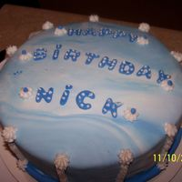 Satin Ice  First time ever working with fondant. White Satin Ice, with blue coloring. Looked like clouds. Buttercream accents, Butter pecan with BC...