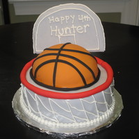 Hoops mini sports ball on 8 inch round. Fondant with buttercream
