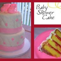 Baby Girl Shower Cake Cake is lemon with strawberry filling, covered with fondant. Booties on top are plastic.