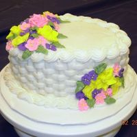 Basket Cake This was my finale cake for Wilton Cake Decorating Course 2. Royal Icing flowers...the rest is Buttercream Icing.