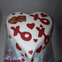 100_5208.jpg Yellow cake, vanilla buttercream, XO made from cookie cutter and bears made out of clay mold...