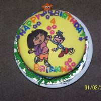 Dora The Explorer Cake- View 1 Cake order: Yellow cake chocolate buttercream, my first time doing chocolate transfer, I made many mistakes however that was my first time...
