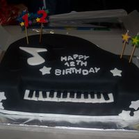 Piano Cake Yellow with vanilla buttercream, birthday boy plays piano