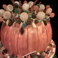 Pumpkin Trick Or Treat   pumpkin shaped cake , with butter cream icing painted pumpkin orange , filled with tons of candy,