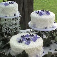 Lacey In Purple 3 round cakes lacey look on top with purple gum paste flowers