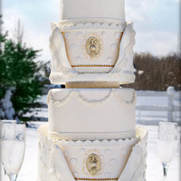 White And Gold Collar Cake 4 tier round white and gold wedding cake with a pastillage collar. The collar was attached to the cake board with white chocolate. It took...