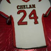 Football Jersey My first carved cake. Almost a full sheet cake (4 individual cakes), half chocolate half carrot with bavarian cream filling and crusting...