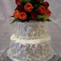 Wedding Red velvet with Decorator's Cream Cheese Frosting. This is my first paid for wedding cake, the bride gave me a picture of a cake that...