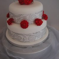 2 Tier Carnations 8inch sponge and 6 inch round fruit cake with handmade carnations