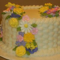 Course 2 Cake - Buttercream With Royal Icing Flowers I just finished this cake today in class. It's the 4th cake that I have ever decorated. While I was doing the basket weave I got...