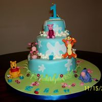 Winnie The Pooh & Friends 1St Birthday This is my 1st try at covering a cake with fondant, stacking & also making gum paste figures/accents. A great thanks to aine2 whose...