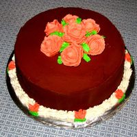Wilton 1 Class Cake It's a dark chocolate cake with chocolate buttercream...peach roses and peach sweetpeas. I was really pleased with this, because while...