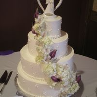 Cascade Fresh hydrangeas, purple callas and purple accented lilies beautifully cascade down to finish this classic cake. Cream cheese italian...