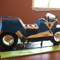 Motorcycle Cake I had so much trouble with this cake. It is all cake except the wheels. Chocolate cake, buttercream , and covered with MMF.