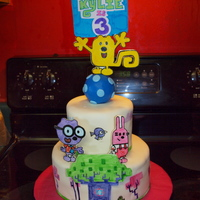 Wow Wow Wubbzy! This is a Wow Wow Wubbzy cake I made for my daughter. It is covered in MMF and the characters are made out of gumpaste.