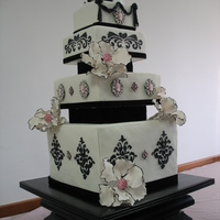 Pink And Black Victorian Wedding All cake except for black stand and black velvet dividers and topper. Brooches and flowers made from gumpaste.