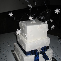 Snowflake Square Wedding Cake Inspired by a photo the bride had of another cake......fondant with gumpaste snowflakes