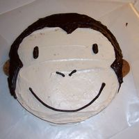 "Curious George Monkey   This is a quick, simple way to do a cake for a kid that wants a monkey or curious george. 10"" round. Used cookies for the ears."