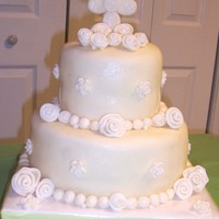 First Communion Round Tiered  This is the first time I ever covered a cake in fondant or made flowers. Cake is covered in mmfondant, gumpaste/fondant mix cross, fondant...