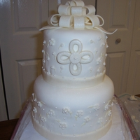First Communion White Round Tiered All fondant accents with shimmer brushed on. First time doing bow.