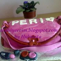My First Purse Cake  I finally did the purse cake.This was a birthday suprise for my niece Perinur.She is 20 now.I used the tutorials here on CC and thanks to...