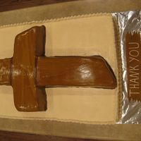 Pastor Appreciation   This cake was made for our church's Pastor appreciation celebration. It is a full-sized sheet cake with a large cross on top.