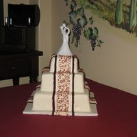 Red, Black And White Wedding I got the idea for this cake out of the Wilton yearbook and tweaked it a little.