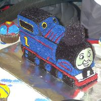 Thomas The Train   I made this cake for my son's second birthday. I used the Wilton 3D train pan and just embellished from there.