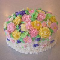 Basket Weave With Flowers Had been making all the flowers in this class and decided to load the cake up.