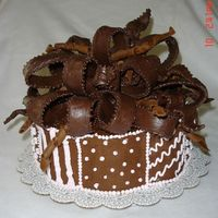 Chocolate_Bow__105.jpg This was for one of my best friend's 50th birthday ( she loves dark chocolate). Bow is MM fondant with dark chocolate and gum paste....