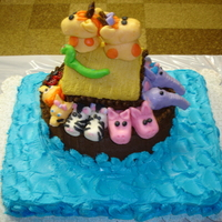 Noah's Ark 1St Birthday Cake Made this for my grandson's 1st birthday. WASC cake for water with buttercream. Chocolate ASC cake for the ark. Top of the ark was...