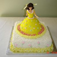 Princess Belle Cake Yellow pound cake for the doll cake, royal icing accents in pink and green. Fondant and buttercream on the doll cake with sparkles....