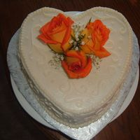 Fall Anniversary Cake W/ Roses   Heart shaped carrot cake w/ cream cheese frosting. Real roses.