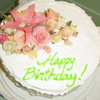 L_3F9Dacb963A546A9D6Dbf85C2573.jpg White cake with raspberry filling and whipped cream topping. Gum paste flowers