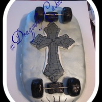 Skating On To New Beginnings  This is a carved white cake with MMF. The cross is frozen buttercream transfer, the wheels and trucks are cereal treats covered in fondant...