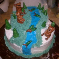 Beary Happy Bears, fish and trees are gumpaste and painted with luster dust and vodka, water is colorflow. Chocolate cake with buttercream