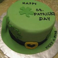 "St_Patricks_09_005.jpg plain green hat, 3 layers 9"" round cake, made from scratch yellow cake pistachio filling(green color), fondant covered and fondant..."