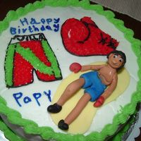 Boxing Mexican Guy I made this cake for mi mom's husbands birthday,he likes boxing , buttercream covered,boxer made of fondant...HE WAS MY FIRST PERSON...