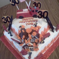 House On Fire! This was a cake that I made for my cousin Tommy for his 30th. birthday! The bottom layer is chocolate fudge with chocolate heath filling,...