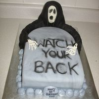 Watch Your Back! For a friend's dad's birthday. He was upset when he turned 30. Nuff said.Chocolate cake with cream filling, covered in fondant....