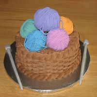 Basket Of Yarn For a lady who knits. Marble cake with chocolate buttercream. The yarn balls are fondant-covered cupcakes. Knitting needles are gumpaste-...