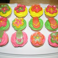 Luau Cupcakes cupcakes for a luau birthday party, bc swirl w/ mmf flowers and flipflops