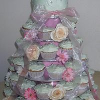Floral Wedding Cupcakes This was an example I made for a customer based on a picture she sent me from a bridal magazine (we changed it heaps). Cupcakes iced in a...