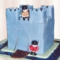 Fort Cake This was for my Dad's birthday. The chain and soldiers were bought, but the rest is cake and fondant. Piping gel moat.