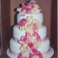 Fresh Roses Wedding Cake This was my first ever attempt at fresh flowers. It turned out really well and has been a very popular cake since!! Fondant covered and...